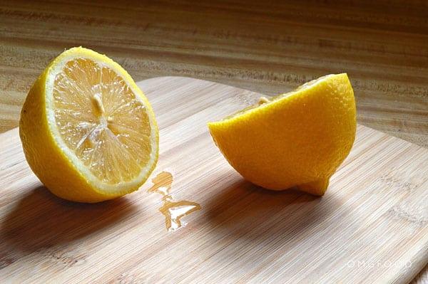 Cut lemon on a cutting board.