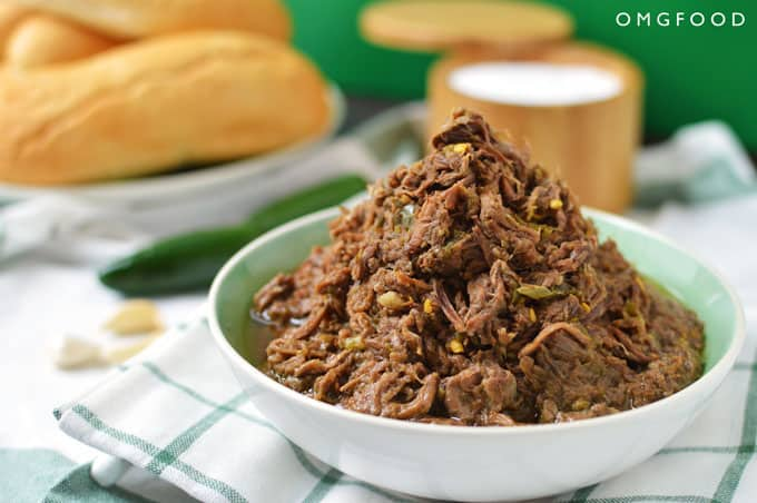 A closeup of shredded beef in a bowl.