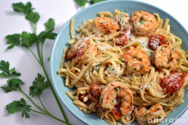 Shrimp scampi and pasta on a plate.