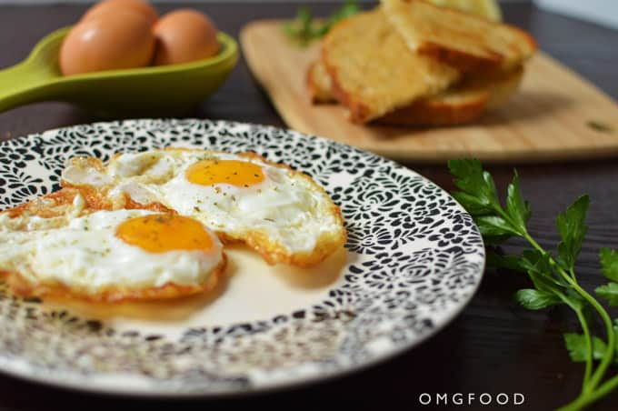 Closeup of fried eggs on a plate.