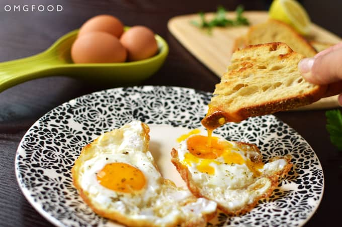 Toast dipping into a fried egg yolk.