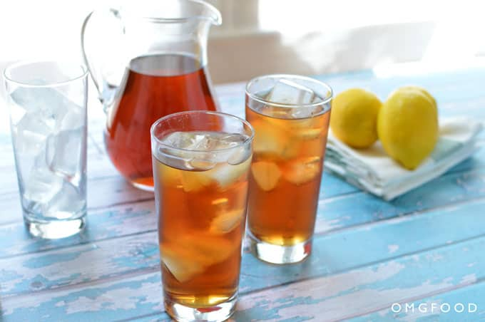 A pitcher and glasses of iced tea.