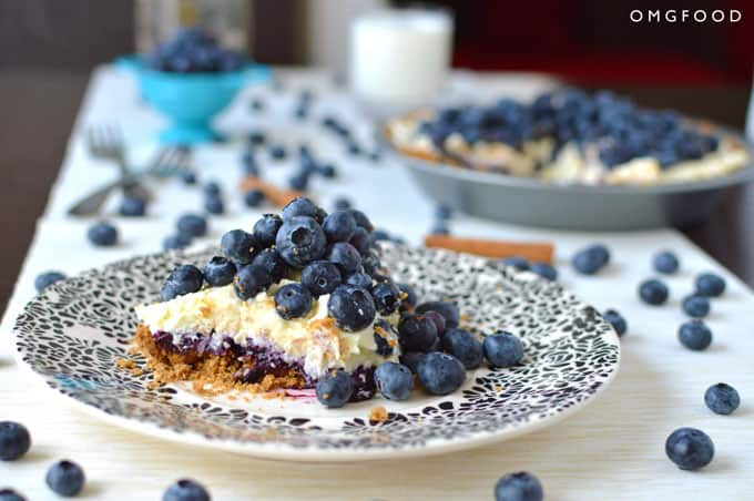 A slice of blueberry cream pie on a plate.