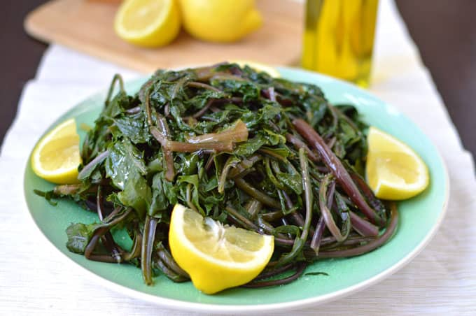 Horta Vrasta - Greek-style dandelion greens boiled and dressed with extra virgin olive oil, fresh lemon juice, and salt. | omgfood.com