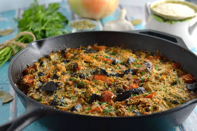 Baked rice with eggplant in a large skillet.