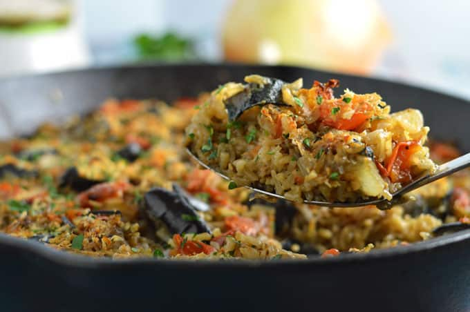 One Pot Greek Eggplant and Rice - An easy to make baked casserole topped with mizithra cheese! | omgfood.com