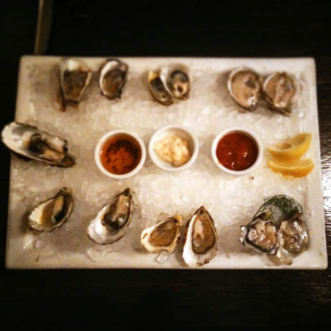 A platter of raw oysters.