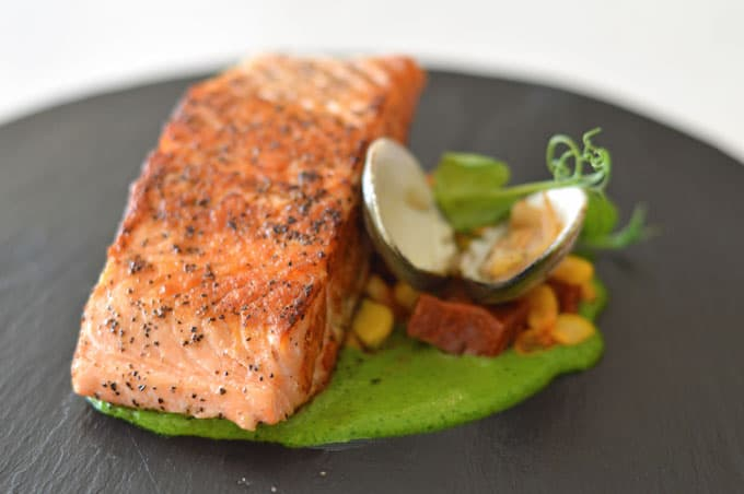 A closeup of salmon on a plate.