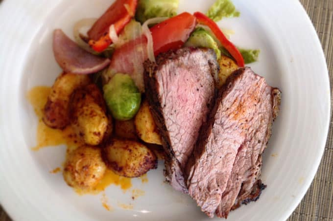 A plate of steak, potatoes, and mixed vegetables.
