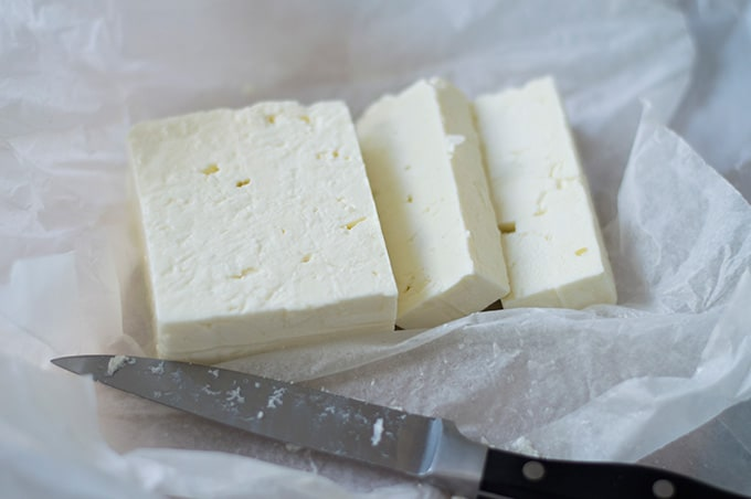 Closeup of sliced feta cheese.