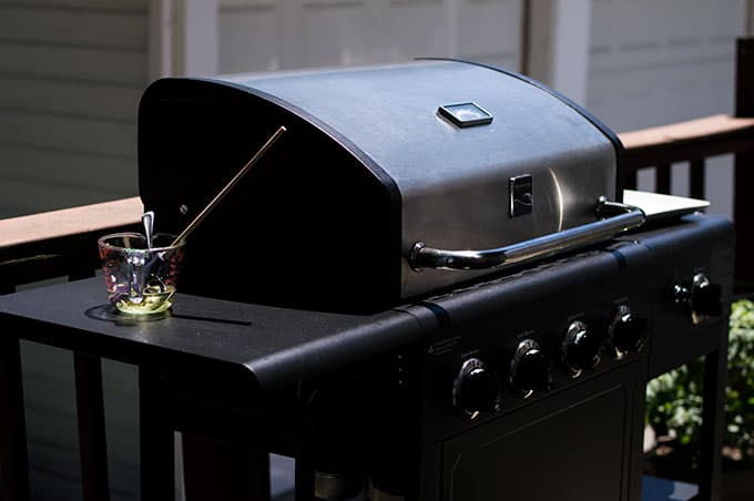An outdoor grill on a deck.