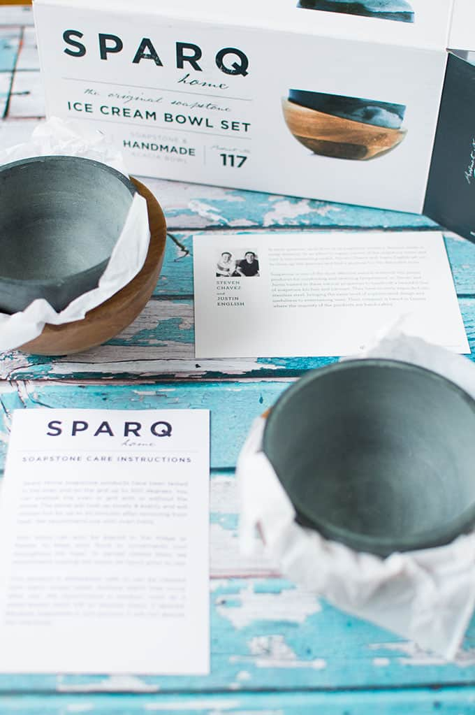 Soapstone ice cream bowls out of a package with care instructions.