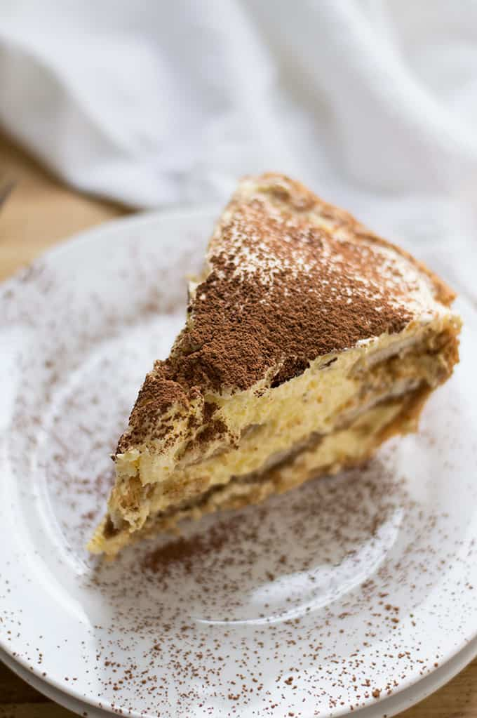 Close up of a slice of tiramisu pie.