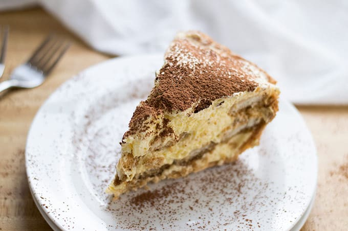 Close up of tiramisu pie on a plate.
