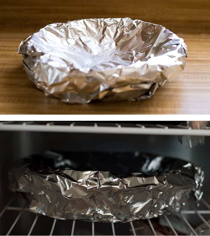 An aluminum foil-wrapped pie pan.