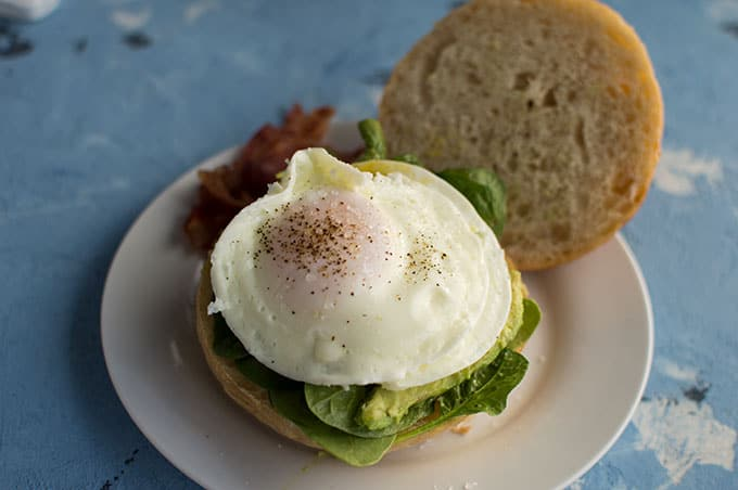 A close up of an open faced egg sandwich.