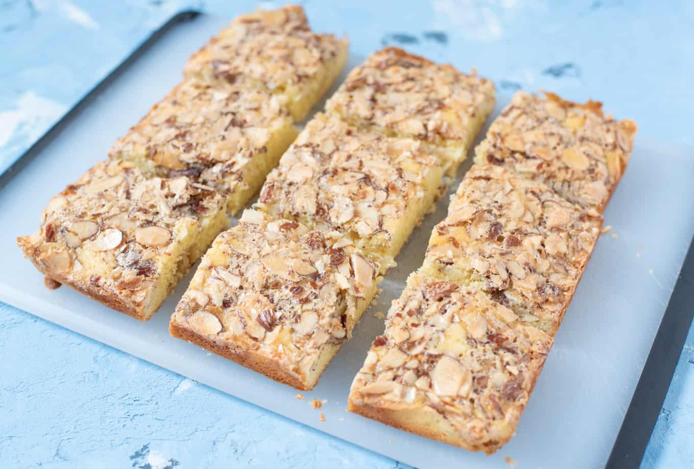 Swedish visiting cake bars resting on a cutting board.