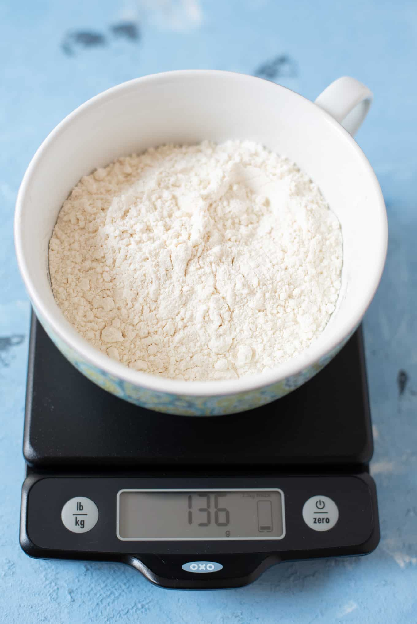 A bowl of flour on a food scale.