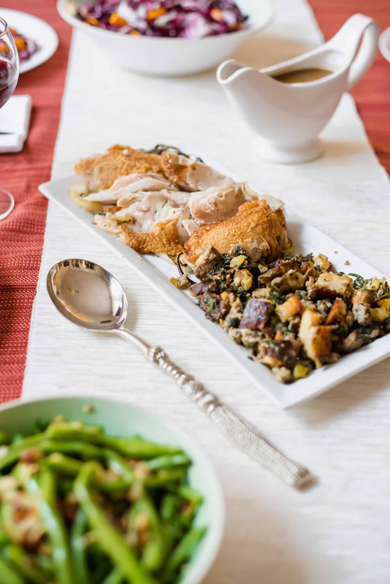 A plate of roasted turkey and stuffing on a table.