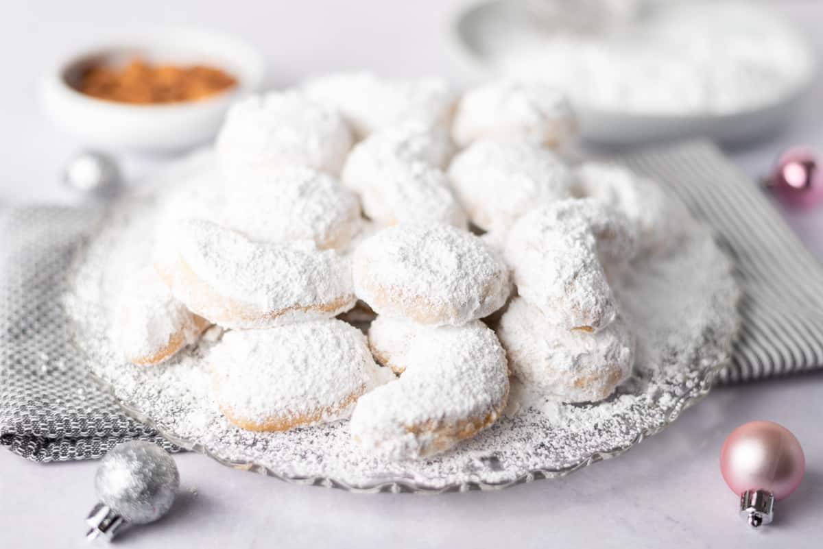 A platter of cookies covered with powdered sugar.