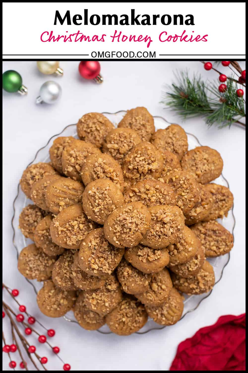 Pinterest banner of a platter of Greek honey cookies and small ornaments on a tabletop.